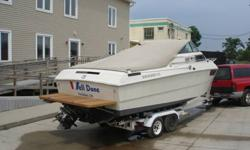 This is a Wellcraft Suncruiser225 and comes with Shorelander trailer. I bought and restored in 2003-2004. This has been repowered with a rebuilt Chevy 305 V8 (228HP) and has approx. 100 hours on engine. Rochester Quadrojet carburetor was replaced with a