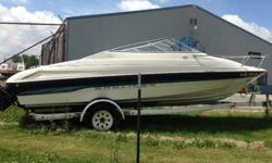 It is a 1995 Bayliner 2052 LS Capri. Previous owner used it on the Bay of Green Bay, so you may have seen them cruising around. The boat has a 5.0 Mercruiser engine with aluminum prop. We sat 6 people comfortably in this boat, with this seating