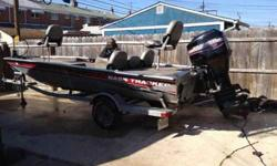 2003 Bass Tracker Pro Team 185 silver anniversary edition boat for sale. 75hp Mercury outboard motor and 24volt trolling motor. LOW HOURS!! Batteries are brand new. Has Hummingbird GPS fish finder, live well, cover is only 1yr old and comes with motor