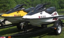 Kawasaki ZXI 1100 jet skis. The yellow one is a 2000 model. The white one is a 2002. The 2009 Nationwide trailer was purchased new and probably hasn't been pulled over 500 miles. They are in good condition and run very well with just normal signs of use.