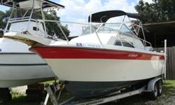 228 Sportsman, 2001 Yamaha Saltwater Series II OX66 fuel injected with 168 hours, Masterload tandem trailer, Anchor, Bimini, Tracking GPS, VHS Radio, fishfinder, am/fm/cd player.
