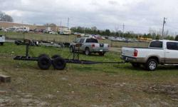 I purchased this trailer with a 26' Seafarer on it and have used it as a yard trailer for the past five years without problem. Tandem 3,500 lb. axles and would handle up to 30'. It comes with three extra tires and rims for $50 more.