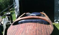 This is a 1950s Wagemaker Wolverine wood boat and trailer. The trailer is in excellent condition, however the boat could use some work. I began restoring it a few years back but don't have enough time anymore. It is halfway finished. Now I'm just looking