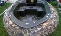 Tobbie Boat Small 2 person boat takes up to 4.5 HP, gas engine or trolling motor comes with rubber tube and camo cover for the rubber tube. Will need a new rubber tube. Have trailer for boat, but will need to be fitted to trailer. Trailer was used for a