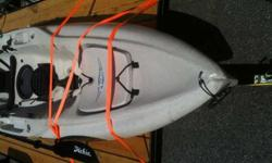 """Hobie Mirage Outback S-U-V kayak in terrific condition. Sand dune color with Hobie comfort seat, two extended rod holders, Hobie paddle, cleats, storage holder and rudder assy with spare shear pin. Drive system excluded. Has small 1"""" crack that has been"""