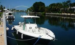 2006 Everglades Boats 26 CENTER CONSOLE This 26? center console is a high quality, versatile, gamily fun, fishing machine with side-by-side seats in front of the console, folding rear seat, bow cushions, twin helm captain chairs. All aboard can ride in