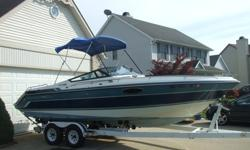 1989 Chaparral 2350 SX Cuddy Cabin. This sharp boat is turnkey with all the equipment. It rides great on big water with the Deep V hull, but also runs nicely on inland lakes. With the Ezloader tandem axle trailer included you choose where to boat. This