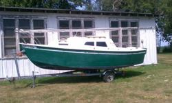 It's a 2000 potter 19 sailboat made by international marine. A small sailboat easily trailed, launched and rigged by one person and takes about 45 mins from trailer to sailing. It has a retractable keel which pulls up into the cabin that makes it easy to