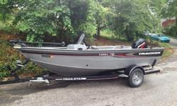 2005 Deep-V Aluminum Boat, 50 hp Mercury Outboard Engine, 2 Livewells, 2 Storeage Areas for Fishing Rods, Storeage Area for Life Vests, Built- in Minncoda Trolling Motor, w/ 2 Trolling Batteries, 3 Position Engine Tilt, 400c Garmin Color Fishfinder and