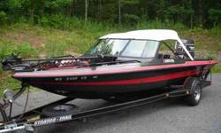 """1990 Stratos Fiberglass Fish and Ski (20' 6"""" long) with 1990 Johnson GT200 VRO motor - two - 15 gallon fuel tanks, two gallon remote oil reservoir - two aerated live wells (1 in front one in rear) - two bilge pumps (750 GPH) - 65 pound thrust MinnKota"""