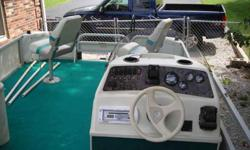 99 Bennington 22 feet pontoon with 70 horsepower evinrude/oil injected with power trim, runs smooth as silk. has two live wells depth finder and four fishing seats and trolling engine also has l-shaped lounge and changing room bimini top and full storage