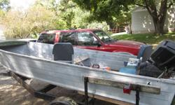 16 foot boat with motor and trailer. call russ 563-260-1521