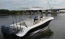 Like new 2007 ordered from factory has twin 250 yamahas and this boat is loaded! 100 hrs on motors! Kept in building, stereo, satellite, raymarine e series, out riggerd, down riggers, three axle aluminum trailer! This ad was posted with the eBay