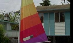 Banshee 13 foot sailboat great condition. Good boat for adults or kids. Very fast and fun. Great lines and rigging. Complete with trailer. Trailer had hubs replaced in 2006, new tires 2006, new bearings Dec 2012. Stored in the garage. I will not respond