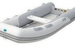 """Perfect for those looking for simplicity and performance in a stowable tender, the two-person Walker Bay Odyssey 240AF (PVC) inflatable boat is the ultimate """"boat in a bag""""--rolling up to fit in the included storage/carry bag to help you get on (or out"""