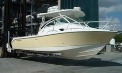 ? Edgewater 265 EX? Fighting Lady Yellow? 2005 November commissioned? Twin 225 Yamaha 4 stroke counter rotating ? 400hrs? Professionally Maintained/Serviced? Hard Top? Eisenglass Cockpit Enclosure (removable)? Reverse cycle AC/Heat? Microwave, Stove,