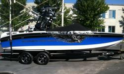 This 2011 Super Air Nautique 230 Team is looking for a new home. This black and blue color combo is a clean classy look on and off the water. The boat is loaded with almost every option Nautique offers and then some. The boat has been gently used with