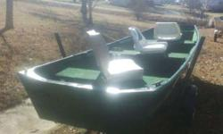 nice jon boat with three padded swivel seats nice trailer and heavy duty motorguide STEALTH 35# thrust trolling engine call in mountain homeListing originally posted at http