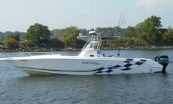 This Donzi ZF cuddy is the ultimate fishing machine. Trailer is included. With less than 250 hours the boat is powered by twin Mercury 250EFI outboard motors, waste no time getting to your favorite fishing destinations. Cruising speed 40, max over 55. The