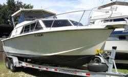 5.7 Vortec fresh water cooled. Customer reports low hours since overhaul. Has large livewell in transom. Great economical fishing boat. New trailer