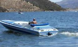 1989 CARIBBEAN BY HARDIN MARINE power boat with cover and bimini top, AND TRAILER..RUN TIME 641 HOUR, 8 feet WIDE, 22 feet LONG, two AXEL TRAILER( NEW TIRES )..ENGINE