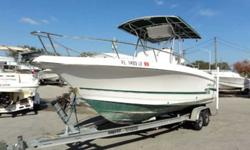 2000 Pro-Line Sport 2000 Pro-Line 23 Sport is a center console. Powered with a single Mercury 225 EFI 2 stroke motor with 588 hours reading on the gauge. Equipped with a marine trailer, t-top, bow cushions, and more. The motor does not run and will