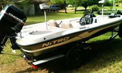 2002 Nitro 700LX with 115 Mercury. 18 ft. Stainless steel Mercury Laser prop. 72 lb thrust Motorguide 24 volt trolling motor. New batteries, New steering cable, new 3 bank 30 amp onboard DualPro Charger, Dual livewell, Hummingbi...rd color depth finder