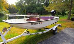 1984 Boston Whaler. This is the highly sought after classic hull design. This boat is in superior condition. Mercury 40 HP four stroke EFI motor was new in 2006, less than 30 hours. Steering system was also replaced. Mahogany interior is new. Trailer was