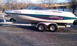 This is a 1996 Rinker Captiva 212 bowrider. Powered with a Mercruiser 5.7, it will have plenty of power to pull wakeboarders, skiiers, and tubers. This boat has a brand new Sunbrella bimini top, custom fit cover, and a tandem axle trailer. This boat is