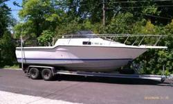 1993 23' Bayliner Trophy walkaround fishing boat. All set up to go fishing on Lake Michigan. Boat has been trailered and stored indoors most of it's life. 175 hp Mercury outboard 25 hp Mercury electric start outboard motor on a bracket to raise and lower