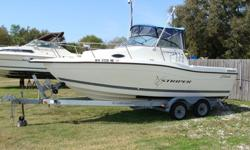 Walkaround, 220HP 4.3 V-6 Volvo FWC, duel batteries with Battery switch, Full canvas enclosure, Cuddy cabin with potti, sink and stove, livewell, Raymarine A65 GPS, Raymarine Ray 54, Pioneer AM/FM stereo, Compass, trim tabs, motor bracket, jump seats,