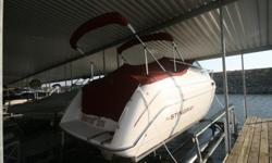1996 Stingray 729 23.5' Cabin Cruiser located at Lake Perry Kansas. Only 205 hours. In above average condition. Kept covered and on hoist when not in use. 2nd owner. 2007 Mercruiser 5.7lt 260hp provides hours of fantastic skiing and tubing. Dual bimini