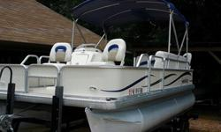 side (midship) fresh water hose hook-up (see photos) to make flushing the engine a breeze! this boat is basically like taking your living room for a cruise with more than ample seating for family and friends. you will find lots of storage compartments