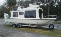 2007 Adventure Craft Houseboat for sale 49,900.00Excellent condition with 2006 135 Honda outboard and dual axle Magnum trailer with brakes and new tires.Upper and lower driving stations equipped with GPS units: bottom station has a new Lowrance HDS 7