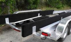 Hello, Hi-Tech Marine Trailers from Fl. Trailers come with the following, Aluminum I Beam and aluminum cross braces and finders. Galvanized torsion axles, wheels and winch stand. Heavy duty winch with heavy duty yellow strap and poly bell stop. Load