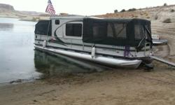 32 foot pontoon with enclosed cabin, full canvas enclosure, 135 hp Mercruiser Alpha I/O, Aluminum Hull, TrailMaster galvanized trailer with built-in access ladder. Low hours, always stored inside,.Upper deck for lounging & storage. Sliding glass doors