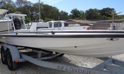 2000 BACK COUNTRY 202 PRO GUIDE IN OUTSTANDING CONDITION POWERED BY A YAMAHA 175 VMAX OUTBOARD ENGINE. ALSO INCLUDED IS FORWARD LIVE WELL, AFT LIVE WELL, RELEASE WELL, POLING TOWER,VHF RADIO, RAY MARINE GPS,JACK PLATE,TROLLING MOTOR,AND MORE. SEE THIS