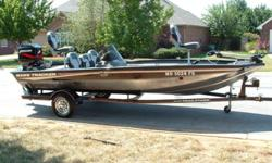 ? CLICK HERE ? ....... Aluminum boat equipped with a Mercury 90HP outboard motor and factory matching trailer. This is a 1 owner fresh water boat that has been on a lift in covered dock. The interior of the boat is in excellent condition front to