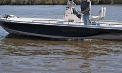 She is 24.5 feet overall and powered by the Suzuki® 300Hp 4 stroke V6 already conditioned with engine corrosion guard recommended by certified Suzuki technician at 20 hours. The boat has a list of additional options like: Gel Coat Two Tone Blue and White