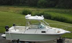 Trophy 2052 Walkaround -190HP I/O, 4 stroke 9.9 Merc- Loaded w/Electronics.Fishing Machine w/Trailer in exceptional condition.The WA (Walkaround) configuration makes for an easy to use boat. Always stored inside, the condition speaks for itself. If you