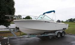21' 1984 Chris Craft older model Dual Console and in Great Shape and ready for the water. 225 HP 4 Stroke Suzuki 2007 Outboard Motor with only 75 hours on it !!!! Tandem Trailer included. This is a very Solid Built Boat. This is a Fishing Boat, has two
