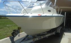 1997 Sunbird Neptune 212 Walk Around Cuddy Cabin in IMMACULATE condition! Comes with Bluetooth radio, VHF radio, raw water wash down, 30+ Gallon livewell, NEW Garmin GPS Chartplotter Fish Finder with Downvu! NEW Bimini Top and frame, 150 HP Johnson Ocean