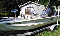 A 2000 Stinger fiberglass boat, 14 feet with a 50 horsepower Johnson motor. Has a depth finder and trolling motor. Also poling platform and front deck seat. 2 six gallon tanks.Many extras included such as life jackets, anchor, and cast net (still in