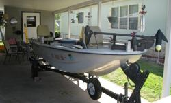 14ft Fiberglas Boat completely renovated, Exc. Cond. has large front casting deck,aerated live well, storage locker, 2 new pedestal fishing seats, New Minkota trolling motor, 2 new batteries, 6 gal gas tank & a 3 Gal gas tank bilge pump, trailer and