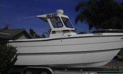 22 foot Pro cat 2004 9 foot six beam custom Pilot House sleeps 3 has a Raymarine radar GPS Fishfinder combo and a Garmin fish finder GPS combo with 3D imaging all electrical is new has two 30 gallon bait tanks built into the stern as Nice stereo amp