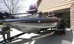 1996 Ranger R70 Sport fiberglass bass boat with metal flake paint.This boat has been garaged its entire lifespan.Very few flaws, carpet and seats in excellent shape. The motor is a 1996 Mercury 125hp elpto, 2 stroke in great shape and runs exceptionally.