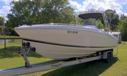 Wellcraft 302 Scarab Sport with twin 2006 Evinrude 250HP E-Tec outboards with 150 hours. Quick Load 2002 tandem axle trailer 10K capacity recently serviced. Stainless steel props.Garmin GPS Chartplotter/Fishfinder with thru hull transducer.Cuddy cabin