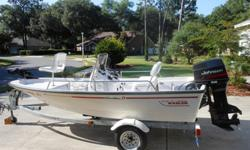 "? '96 Dauntless 13'9"" center console, windshield w/grab rail, bow platform w/storage, pedestal seat.? '96 Johnson 50 HP 3 cylinder, Model # J50DTLEDC, w/ Tilt/Trim? Shoreland'r galvanized trailer, drive on, model # SS-GV1515, nearly new tires? 12 gallon"