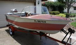 Classic Wooden Boat: 1961 D CRAFT. This classic wooden boat is a 14?0? runabout with a 33 hp outboard motor that originally came with the boat. This boat has the classic dual lever controls. The boat has been garage kept, but does have a custom fitted