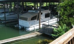 Covered slip for 32' or up to 36' boat. Slip is approximate 12-13' wide and 32' long covered but can accommodate a longer boat. Water at the slip is furnished and power is available. Slip is located at Crazy Horse Marina, SML, VirginiaCall Larry: